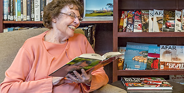 residents reading in the library