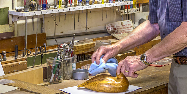 senior working in wood shop at mercer island at covenant shores retirement community